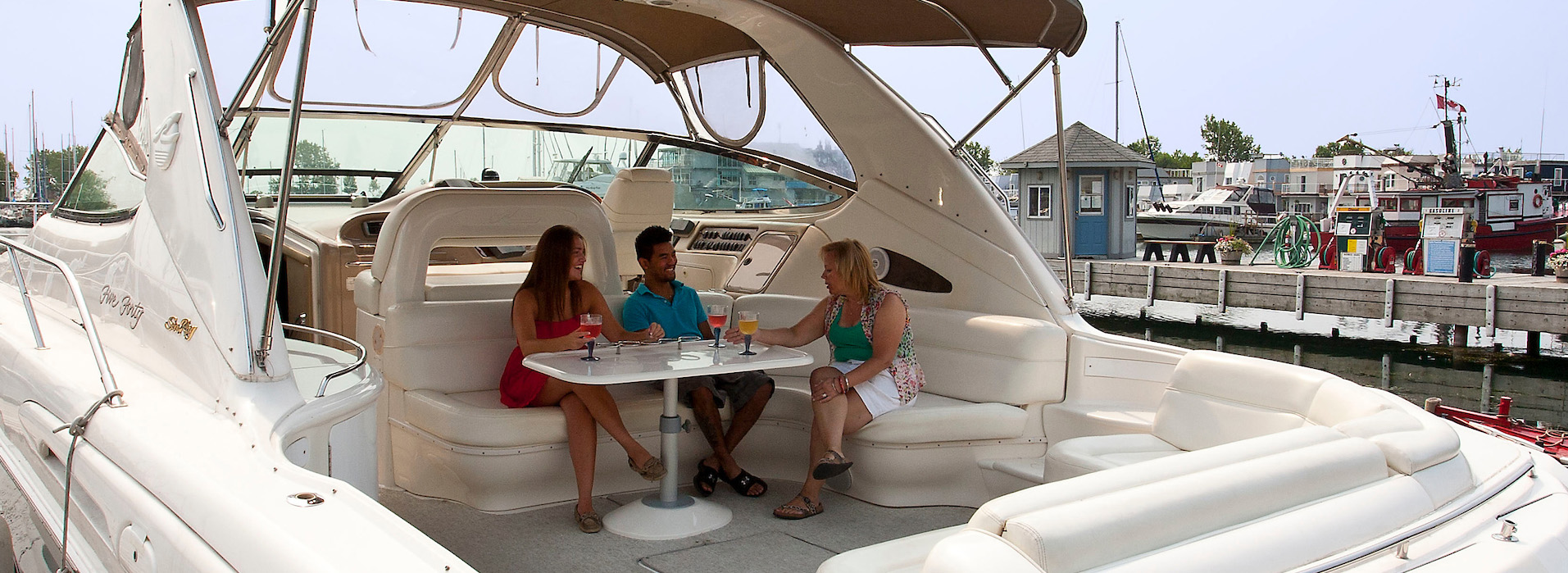 People enjoy a drink together on their boat which is docket at Bluffers Park Marina, Toronto's only full service marina.